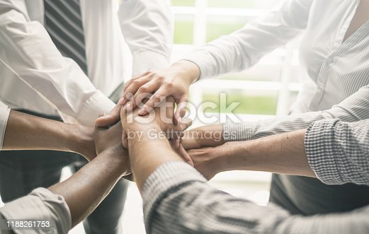 937843262 istock photo Stack of hands. Unity and teamwork concept. 1188261753