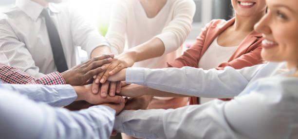 stack of hands. unity and teamwork concept. - coinvolgimento dei dipendenti foto e immagini stock