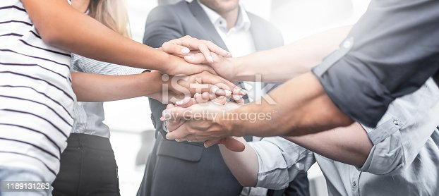istock Stack of hands. Unity and teamwork concept. 1189131263