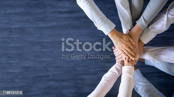 832105860 istock photo Stack of hands. Unity and teamwork concept. 1189131315