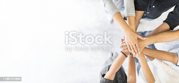 832105860 istock photo Stack of hands. Unity and teamwork concept. 1189131883