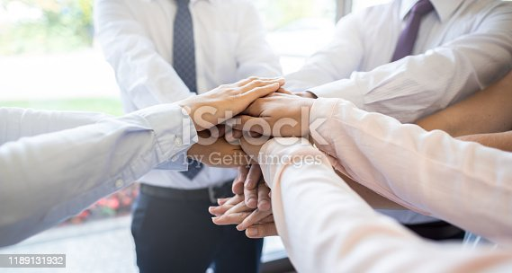 937843262 istock photo Stack of hands. Unity and teamwork concept. 1189131932