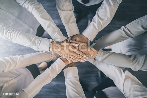 832105860 istock photo Stack of hands. Unity and teamwork concept. 1189131976