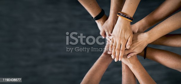 832105860 istock photo Stack of hands. Unity and teamwork concept. 1190408577