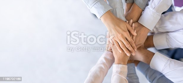 832105860 istock photo Stack of hands. Unity and teamwork concept. 1196702186