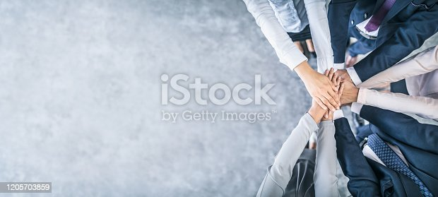 832105860 istock photo Stack of hands. Unity and teamwork concept. 1205703859