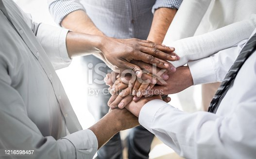 937843262 istock photo Stack of hands. Unity and teamwork concept. 1216598457