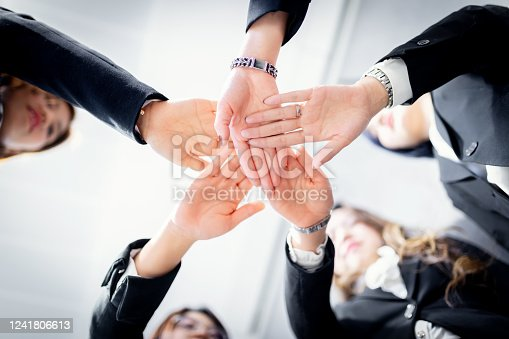 1174511028 istock photo Stack of hands. Unity and teamwork concept 1241806613