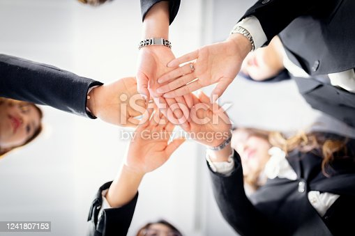 1174511028 istock photo Stack of hands. Unity and teamwork concept 1241807153