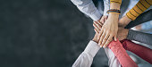 istock Stack of hands. Unity and teamwork concept. 1252483306