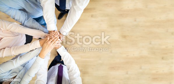 832105860 istock photo Stack of hands. Unity and teamwork concept. 1254584842