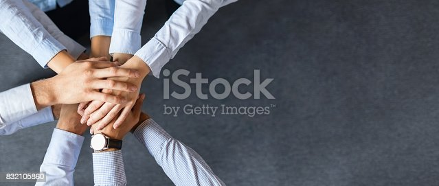istock Stack of hands. Unity and teamwork concept. 832105860