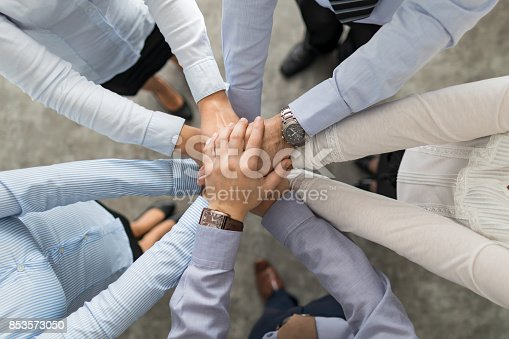 832105860 istock photo Stack of hands. Unity and teamwork concept. 853573050