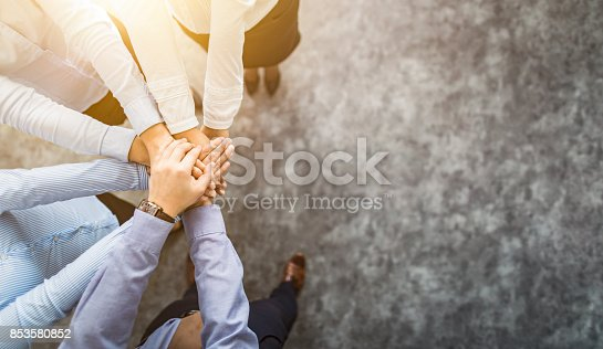 istock Stack of hands. Unity and teamwork concept. 853580852