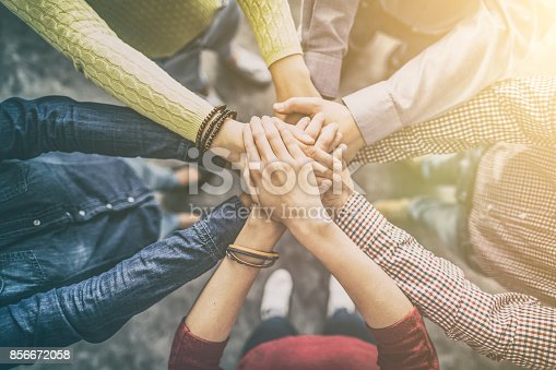 istock Stack of hands. Unity and teamwork concept. 856672058