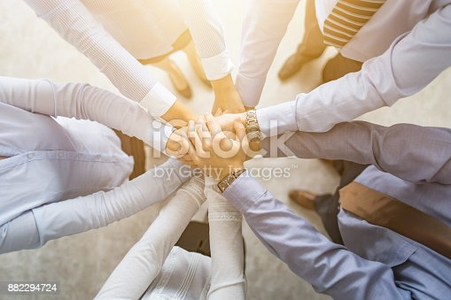832105860 istock photo Stack of hands. Unity and teamwork concept. 882294724