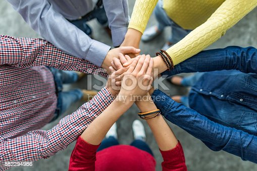 istock Stack of hands. Unity and teamwork concept. 882294986