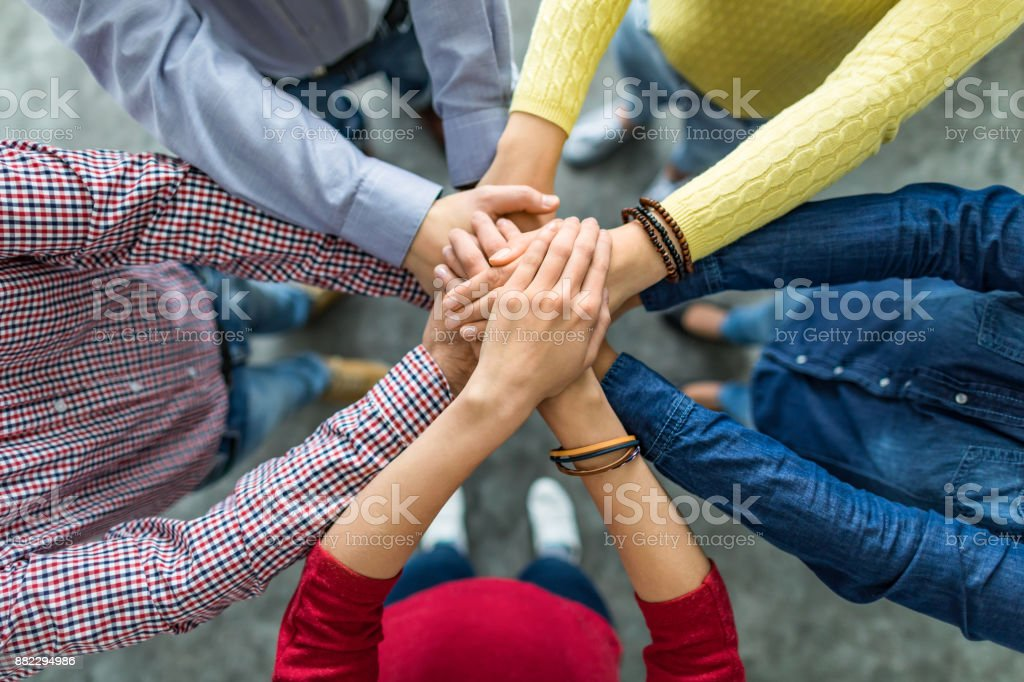 Stack of hands. Unity and teamwork concept. stock photo