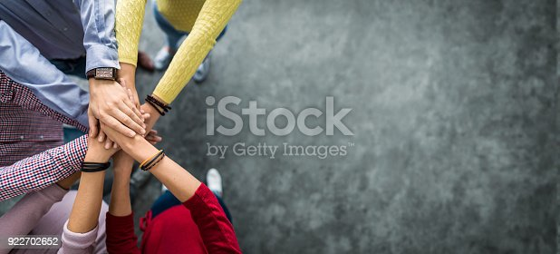 istock Stack of hands. Unity and teamwork concept. 922702652