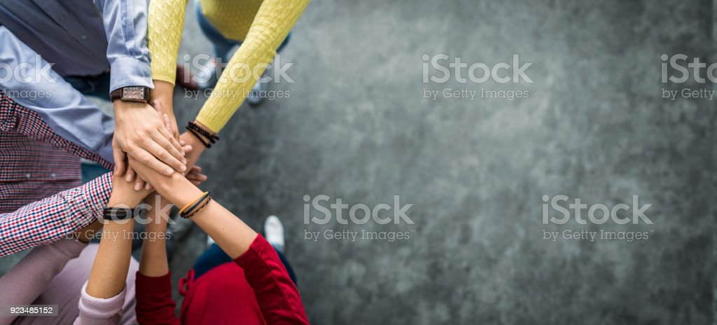 Stack of hands. Unity and teamwork concept. - foto stock