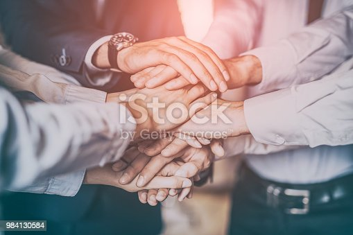 832105860 istock photo Stack of hands. Unity and teamwork concept. 984130584