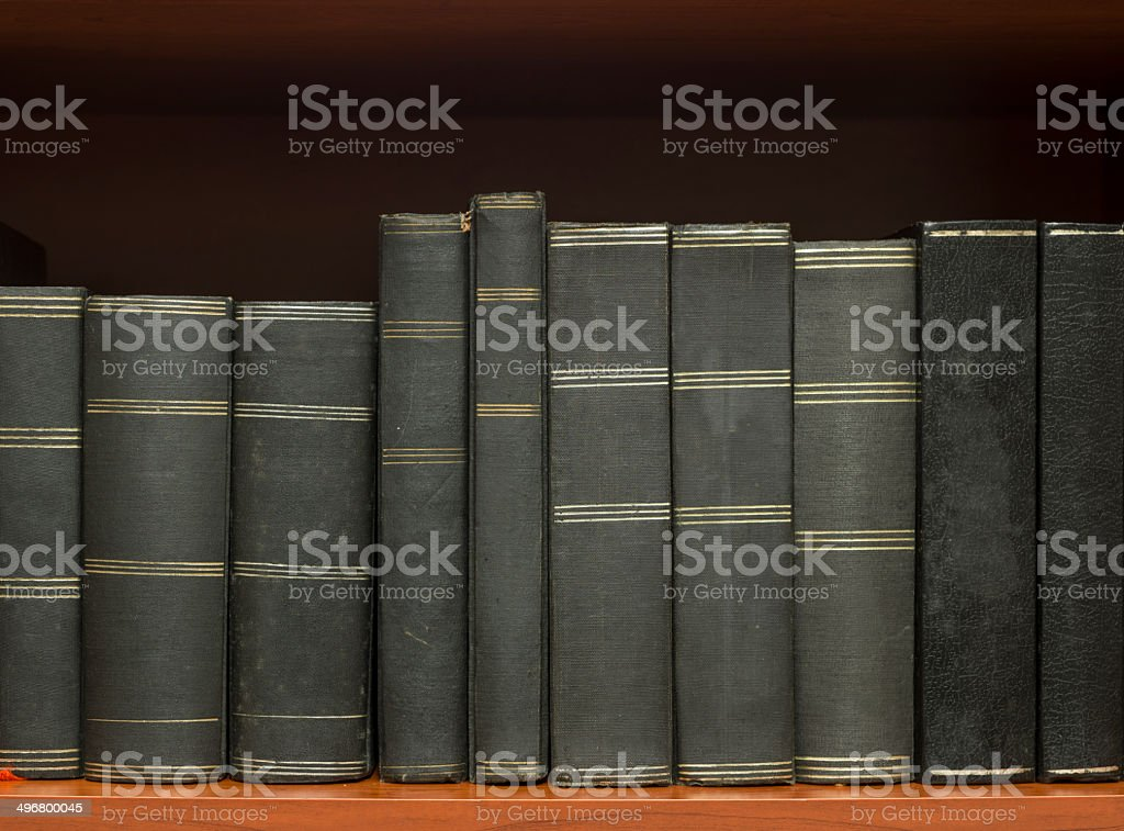 Stack of hardcover books on bookshelf royalty-free stock photo