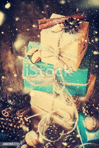 493890050 istock photo Stack of Holiday Boxes with Cord, Nuts. Drawn Snow 496386222