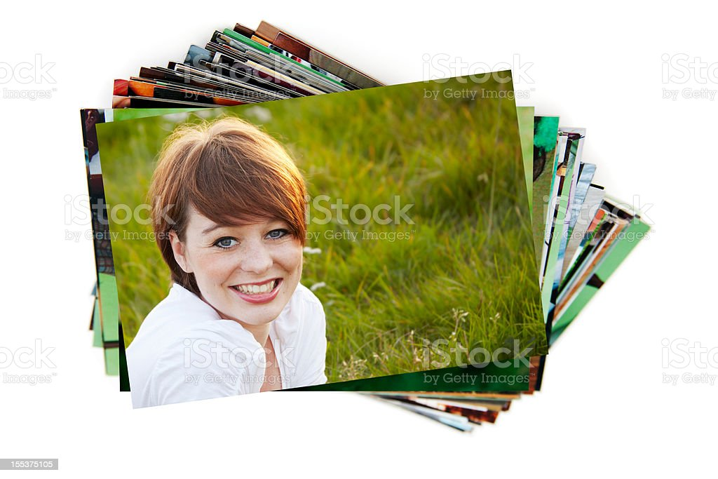 Stack of holiday photographs on white stock photo