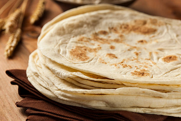 stack of homemade flour tortillas - tortilla stock photos and pictures