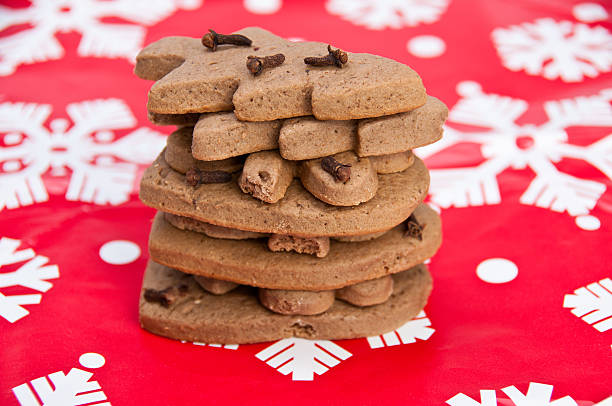 Stack of homemade gingerbread on Christmas paper stock photo