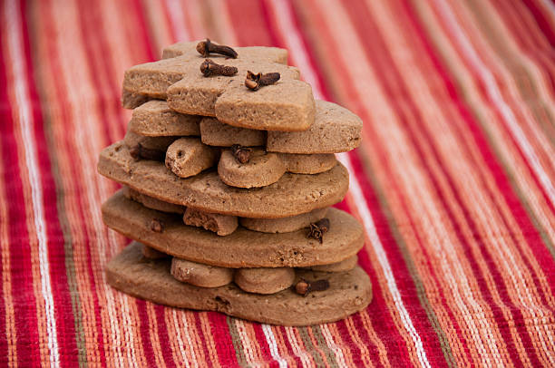 Stack of homemade gingerbread on decorative red napkin stock photo