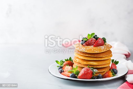 istock Stack of homemade pancakes for breakfast with berries 931351644
