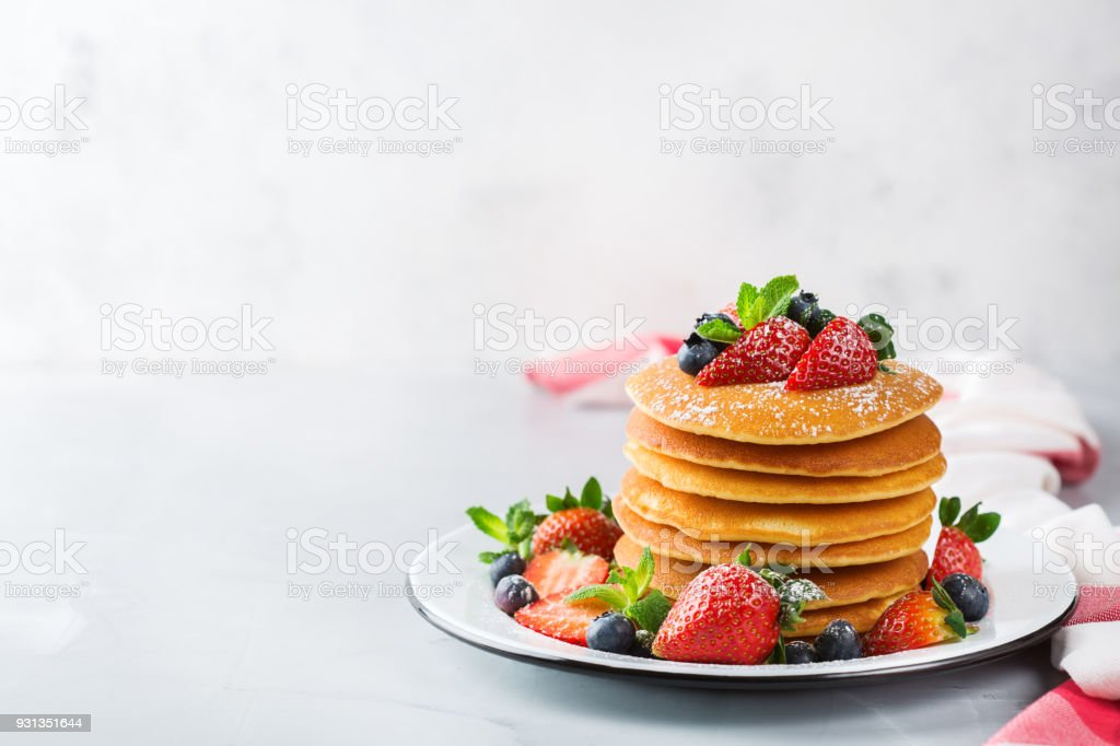 Stack of homemade pancakes for breakfast with berries stock photo