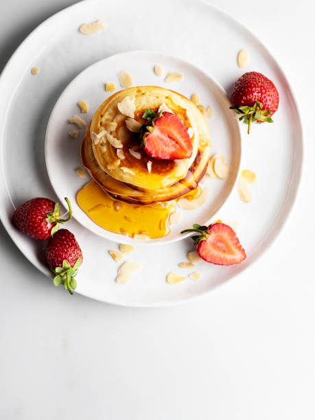 Stack of homemade pancakes for breakfast with berries,Pancakes with honey and Strawberry, Pancakes stock photo