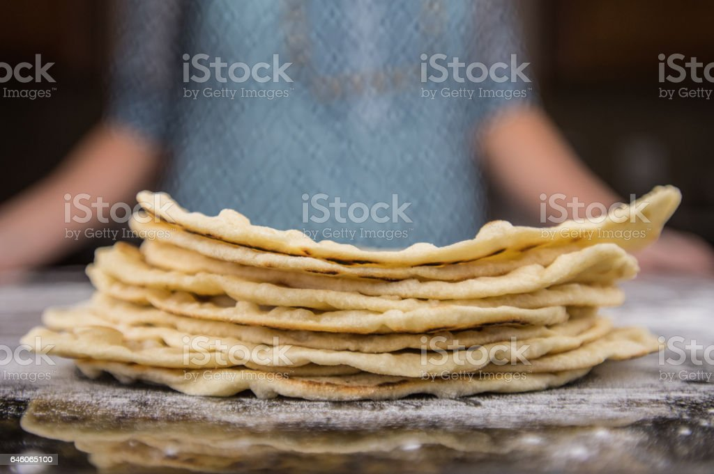 Stack of Homemade Tortillas on floured surface stock photo