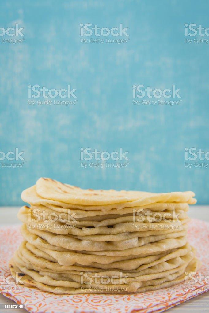 Stack of Homemade Tortillas on Orange Napkin stock photo
