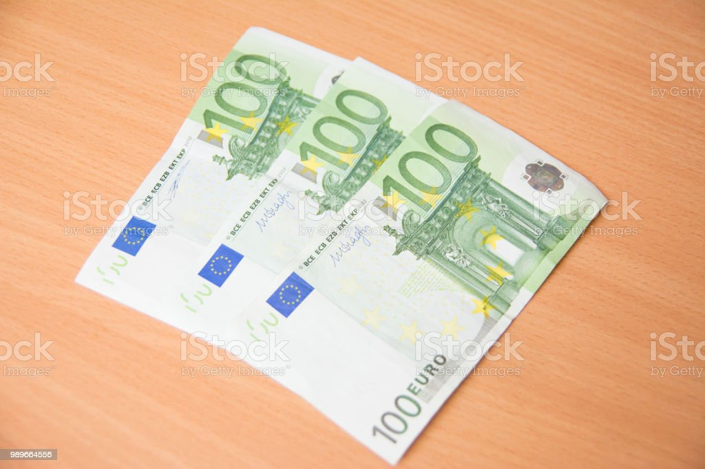 Stack of hundreds euro banknotes in order stock photo