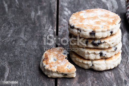 Stack  of iced Welsh cakes on rustic wooden table