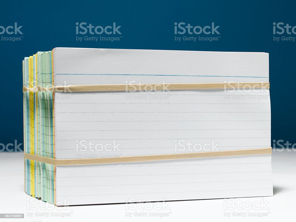 A stack of index cards held together with rubber bands royalty-free stock photo