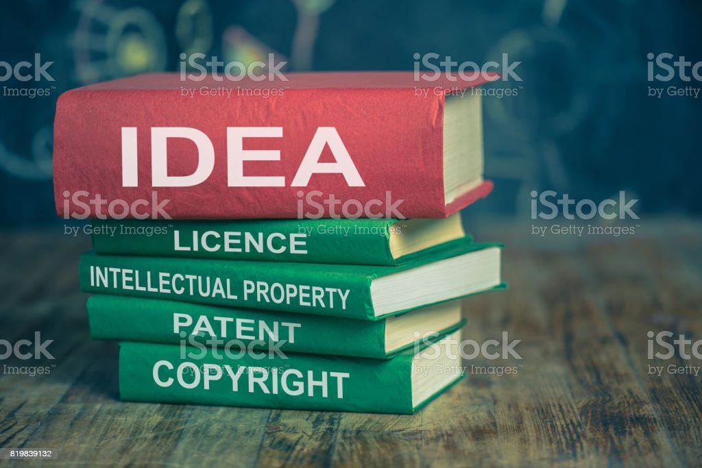 Stack of intellectual property related books - foto stock