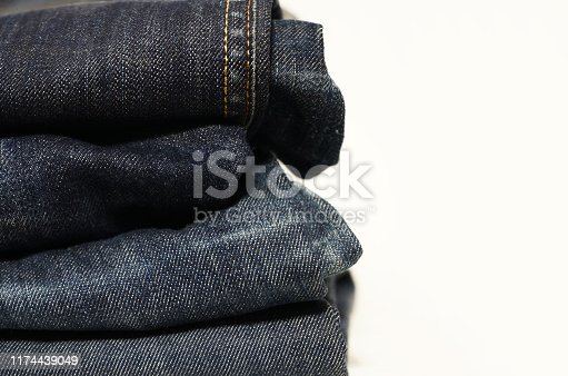 Stack of jeans, white background