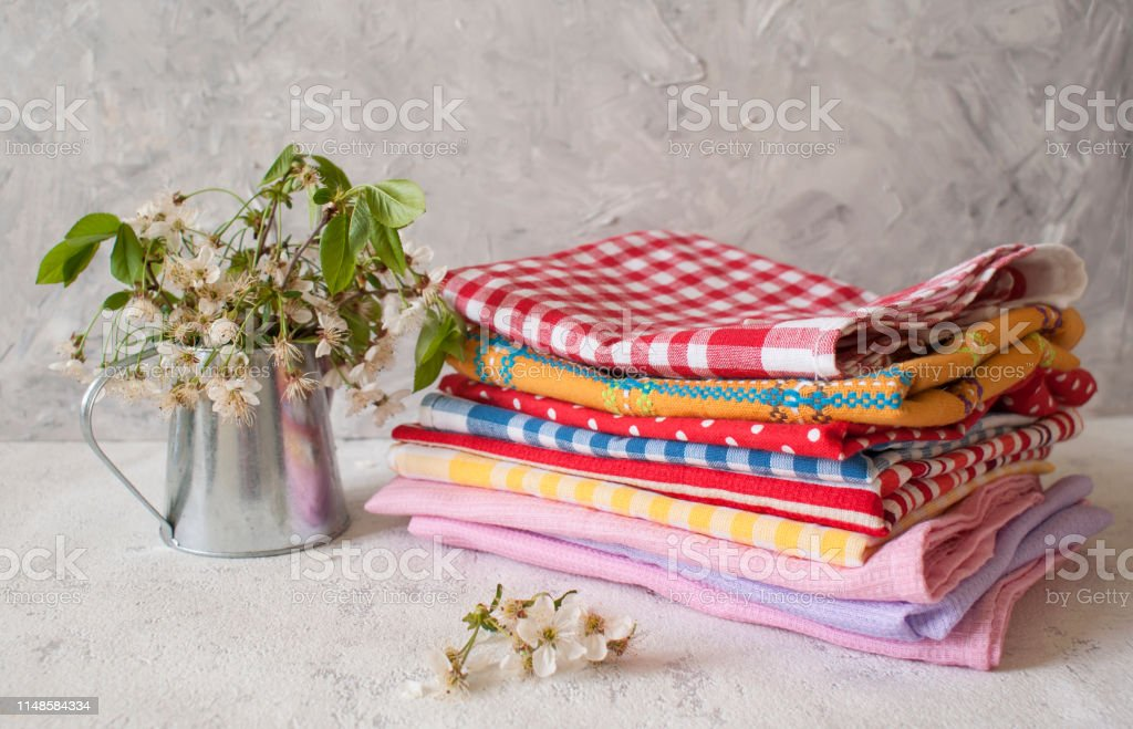 Stack Of Kitchen Towels On A Light Textured Background Standing Next To Vase With Flowers Of Apple Trees Stock Photo Download Image Now Istock