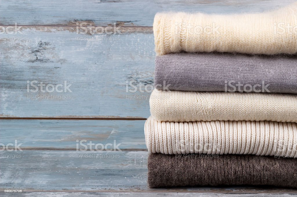 Stack of knitted sweaters stock photo