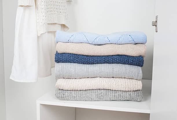 Stack of knitted warm woolen clothes stock photo