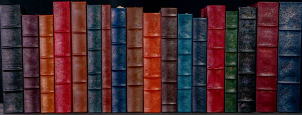 A stack of leather bound books stock photo