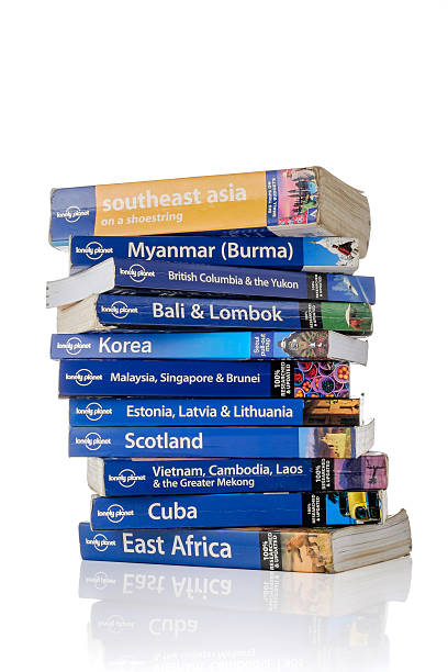 Stack of Lonely Planet guide books stock photo