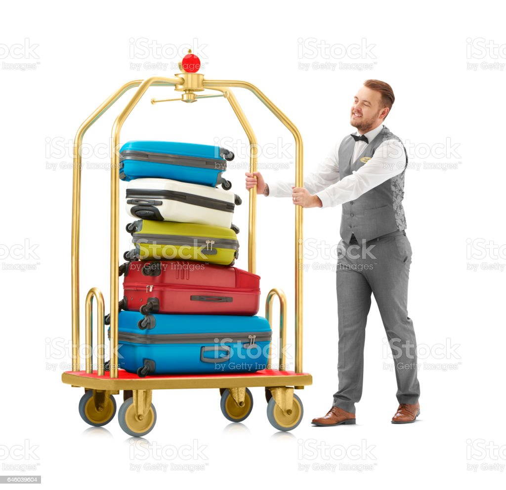 stack of luggage being pushed by hotel worker stock photo