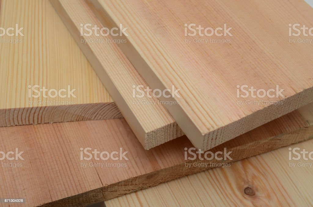 stack of lumber in timber logs storage for construction or industrial work , texture background stock photo