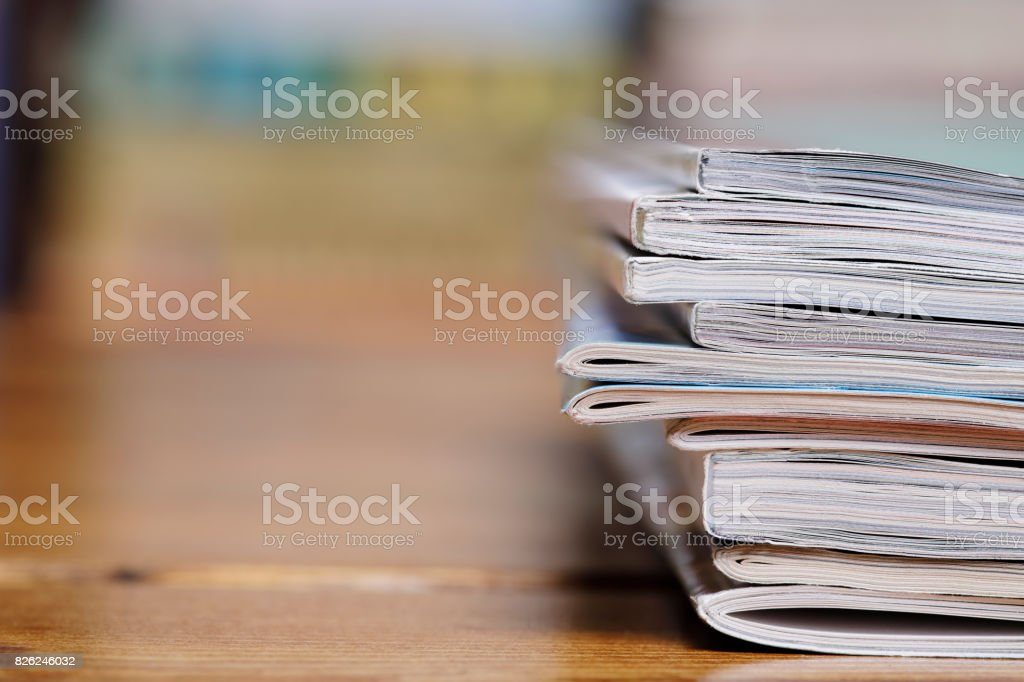 Stack of magazine extreme close up with copy space stock photo