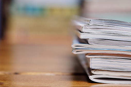 Stack Of Magazine Extreme Close Up With Copy Space Stock Photo - Download Image Now